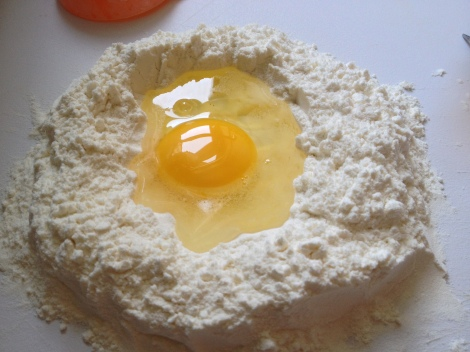 egg in a crater of flour