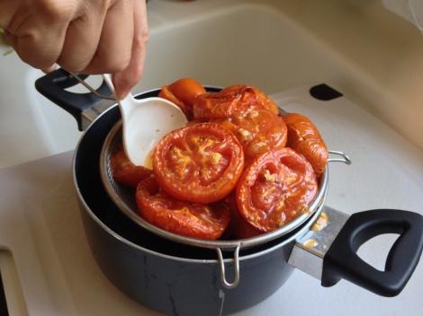 mash the tomato through a sieve
