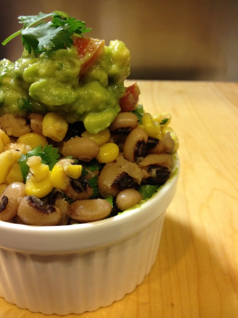 we like to top our salad with guacamole since the light creaminess compliments the crunchiness of the corn