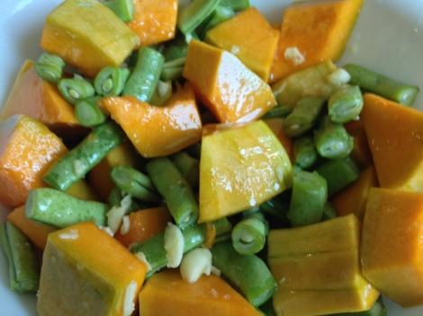 toss the cut veggies in oil, garlic, and salt