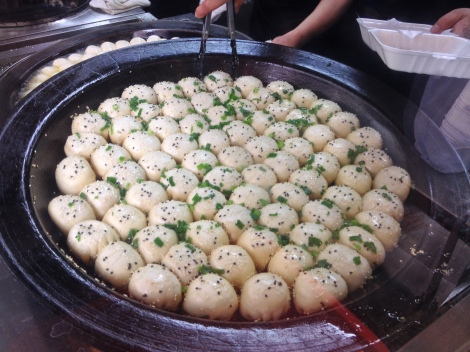 the freshly made pan-fried baos