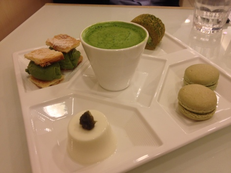 in this dessert set, they serve the green tea ice-cream puff pastry sandwich, green tea swiss roll, green tea macaron, green tea with mochi, and panna cotta