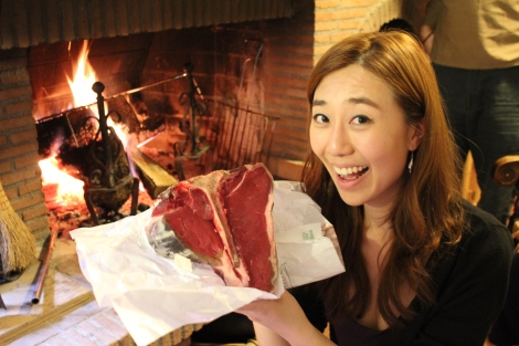 that steak is bigger than her head!
